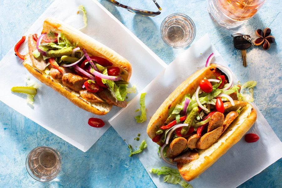 Italian sausage sandwiches with roasted red pepper salad and cornichons