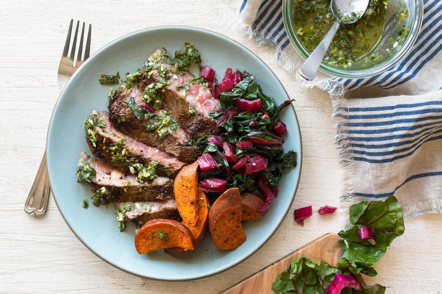 Grilled steaks with chimichurri and harissa-roasted sweet potatoes