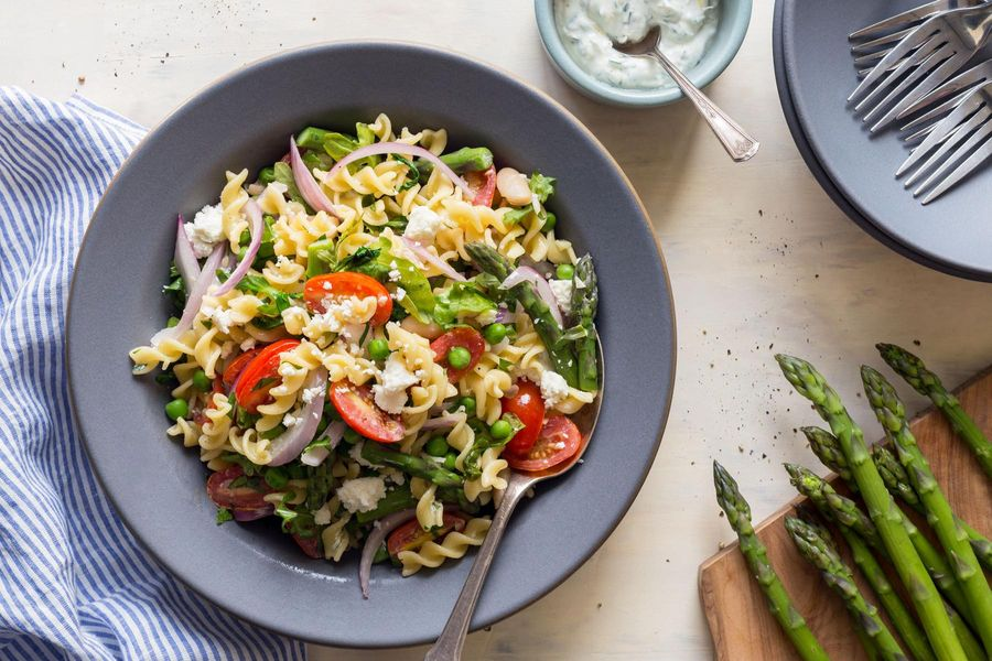 Gluten-free pasta salad with asparagus and parsley-yogurt dressing