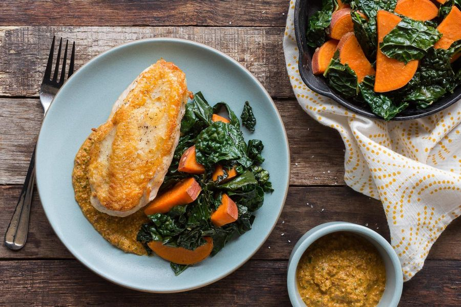 Roast chicken breasts with kale, sweet potatoes, and artichoke romesco