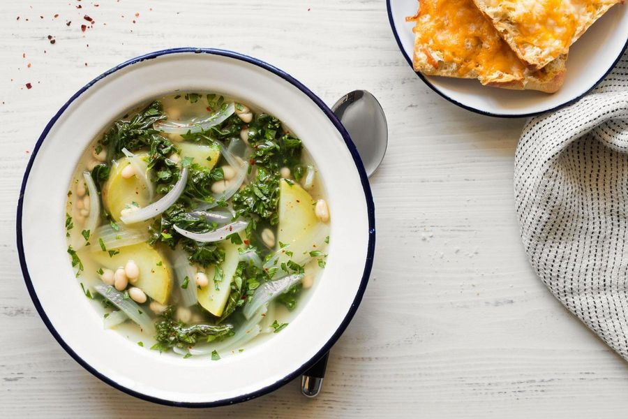 Kale, white bean, and potato soup with cheese toasts