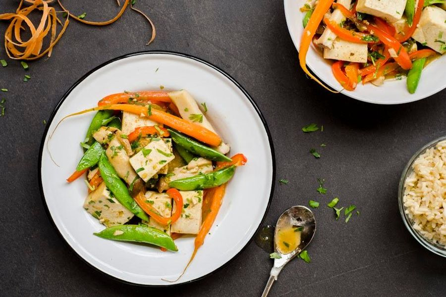 Tofu and spring vegetables with green curry and brown rice