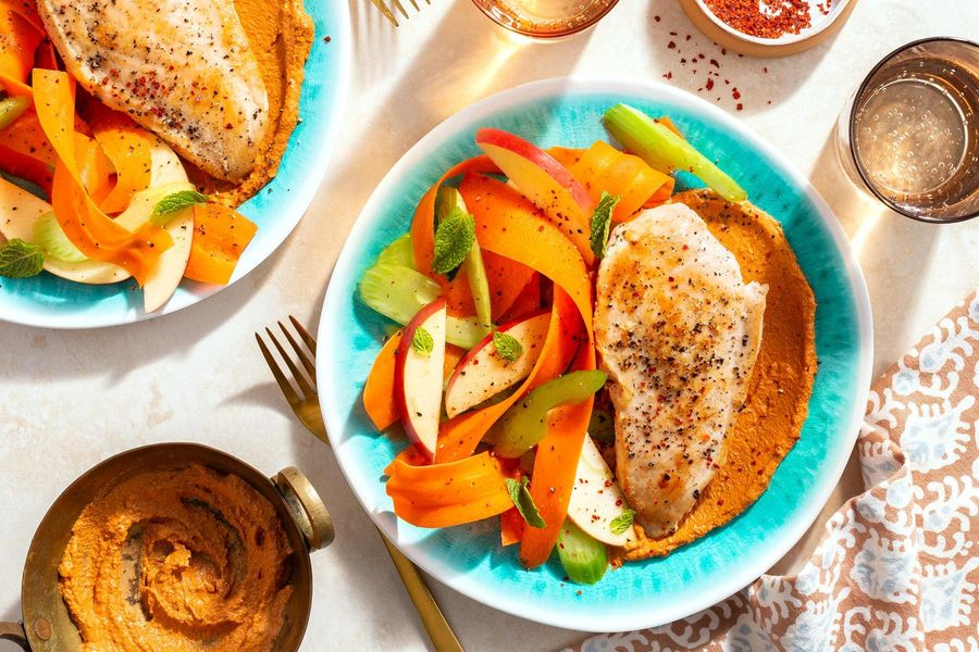 Chicken breasts and muhammara with apple-celery salad