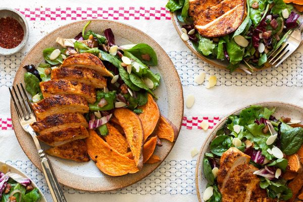 Paprika-spiced chicken with spinach salad and sweet potato fries