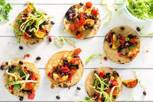 Zucchini and black bean tacos with cabbage–bell pepper slaw