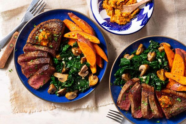 Steak and sweet potato frites with kale and mushrooms