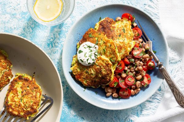 Zucchini fritters with tomato salad and garlic yogurt