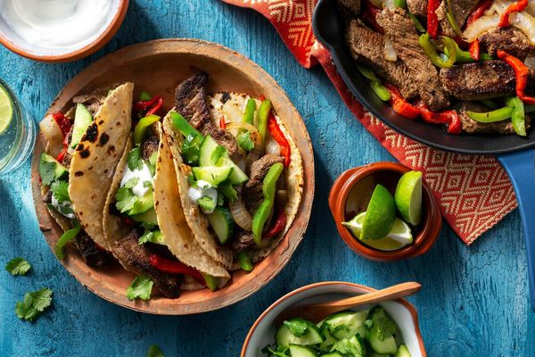 Steak fajitas with roasted red peppers and cucumber salsa
