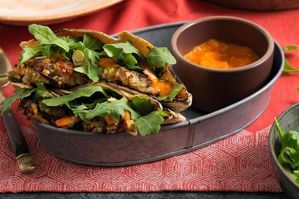 Pakora pita pockets with spicy mango-chile sauce