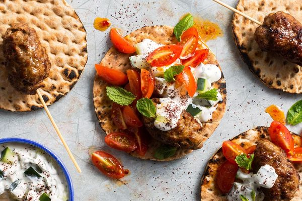 Lamb köfte kebabs with tomato relish and tzatziki