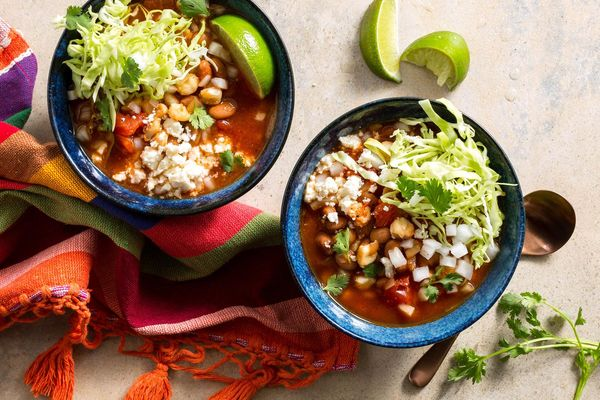 Easy pinto bean and hominy pozole rojo with queso fresco