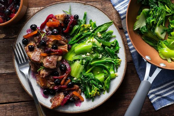 Seared pork with blueberry-apricot sauce and sautéed greens
