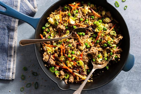 "Pork fried cauliflower ""rice"" with carrots and peas"