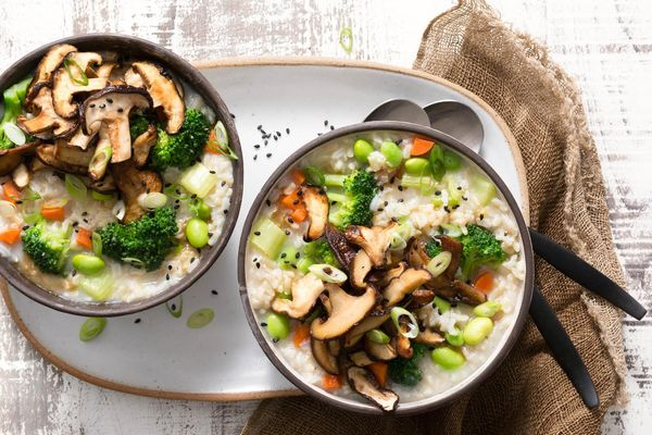 Brown rice congee with edamame, mushrooms, and ginger