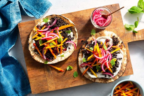 North African black lentil pitas with tangy carrot-cranberry salad