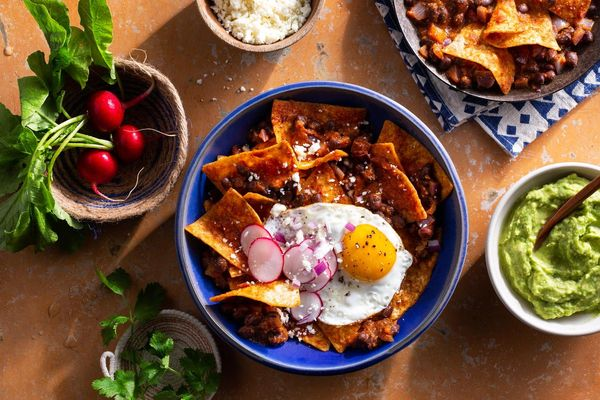 Chipotle chilaquiles with black beans and fried eggs