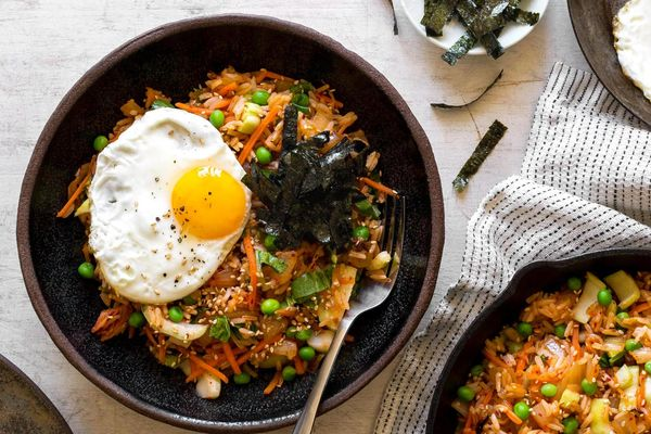 Spicy kimchi fried rice with peas and eggs