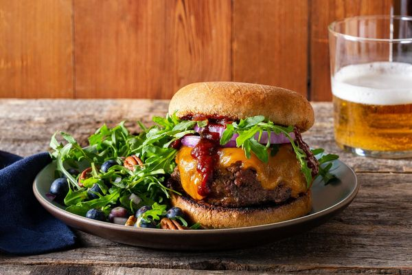 Memphis BBQ cheeseburgers with blueberry, pecan, and arugula salad