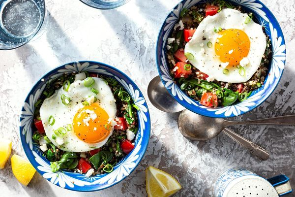 Quinoa-spinach grain bowls with fresh dill, feta, and fried eggs
