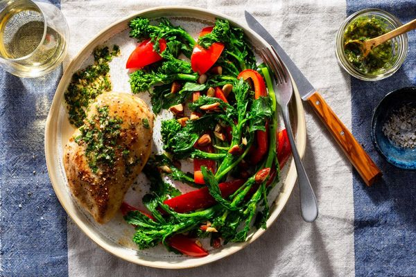 Sicilian chicken breasts with salmoriglio sauce and broccoli rabe
