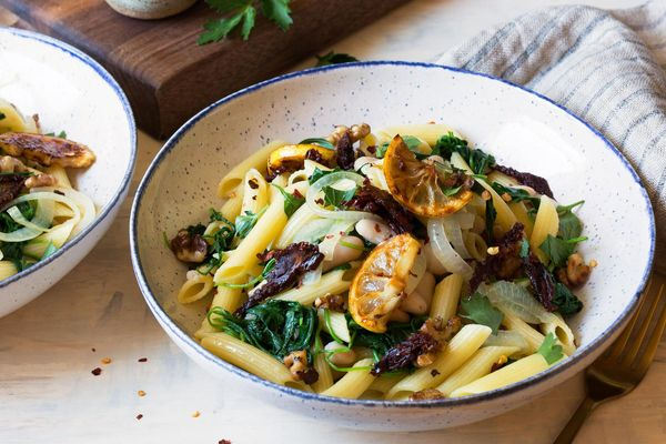 Penne with fried lemons, white beans, and sun-dried tomatoes