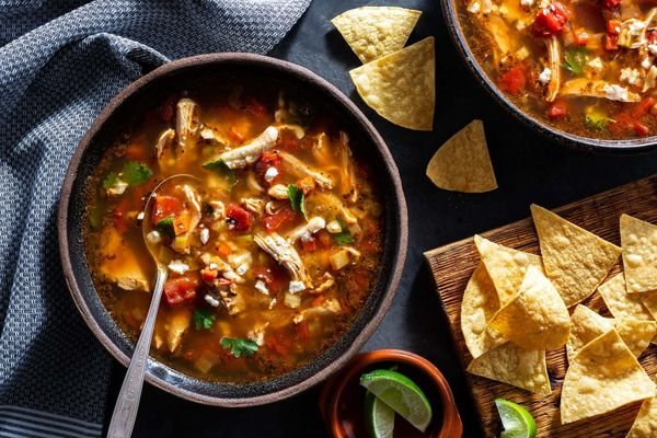Chicken tortilla soup with queso fresco and lime