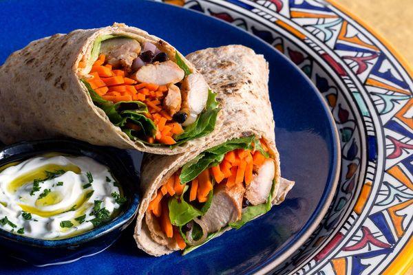 Musakhan chicken wraps with pickled carrots and yogurt sauce
