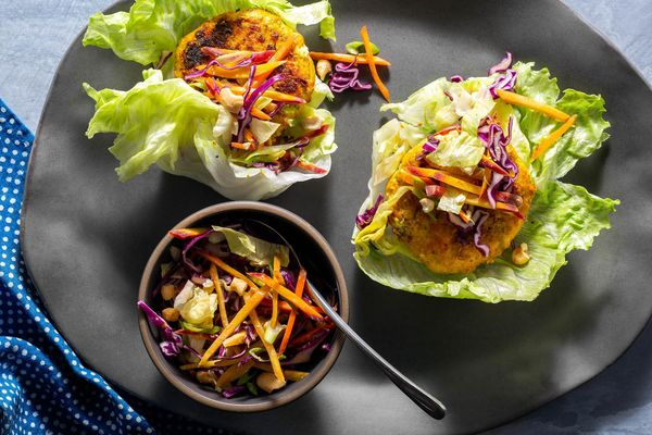 Lettuce-wrapped lemongrass salmon burgers with crunchy Asian slaw