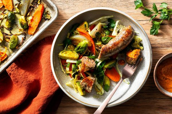 Roasted Italian sausages and spiced vegetables with romesco