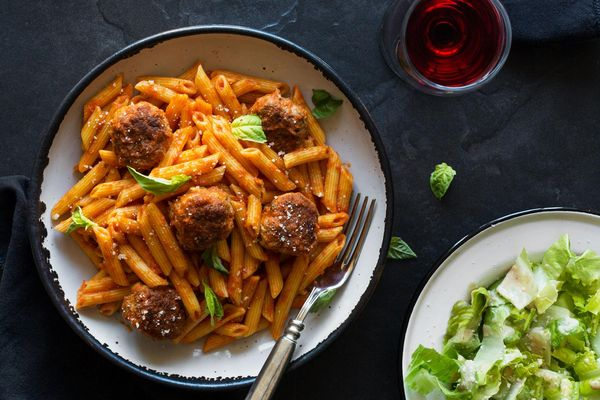 Penne and meatballs in marinara sauce with Caesar salad