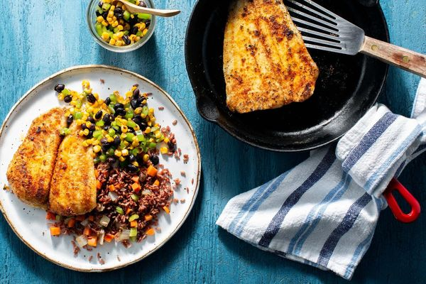 Blackened sole with red rice and charred corn–black bean salsa
