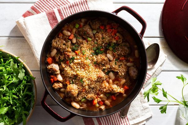 Sausage and white bean cassoulet with arugula salad