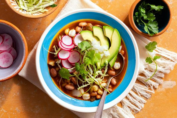 Pozole verde with mild chiles, red radish, and avocado