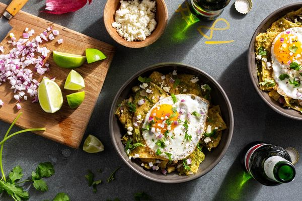 Chilaquiles verde with fried eggs and queso fresco