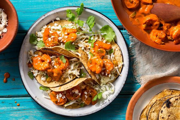 Shrimp tacos diablo with cabbage slaw and queso fresco