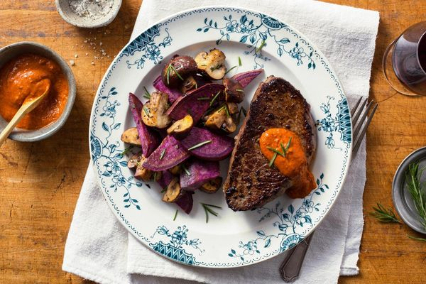 Steak with purple sweet potatoes and roasted red pepper salsa