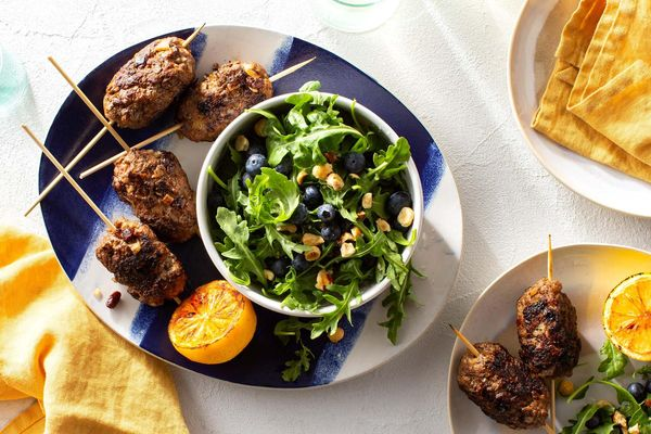 Souzoukaklia ground beef skewers with arugula-blueberry salad