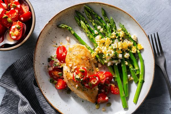 Seared chicken breasts with tomato salsa, asparagus, and chopped eggs