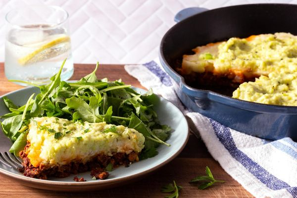 Lamb moussaka with potatoes, skordalia, and arugula salad