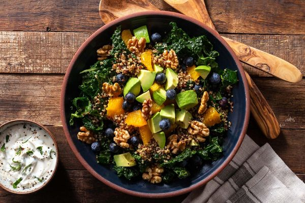 Superfood salad with quinoa, orange, blueberries, and walnuts