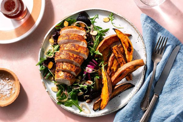 Paprika-rubbed chicken with almond picada salad and sweet potato fries