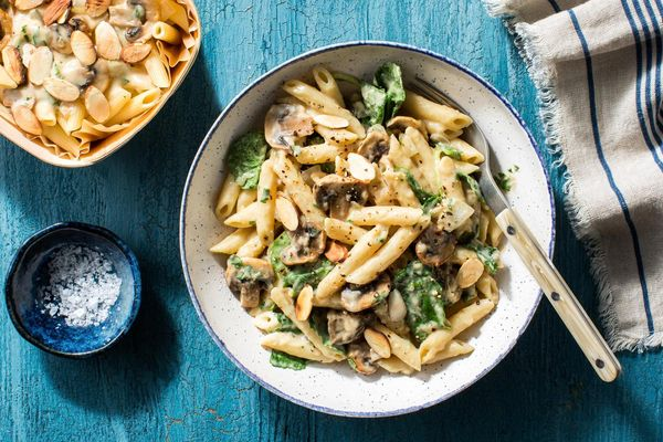 Creamy mushroom penne with baby spinach and almonds