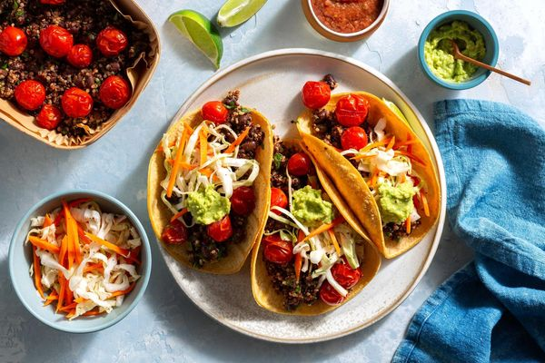 Rainbow quinoa–black bean tacos with guacamole and cabbage slaw