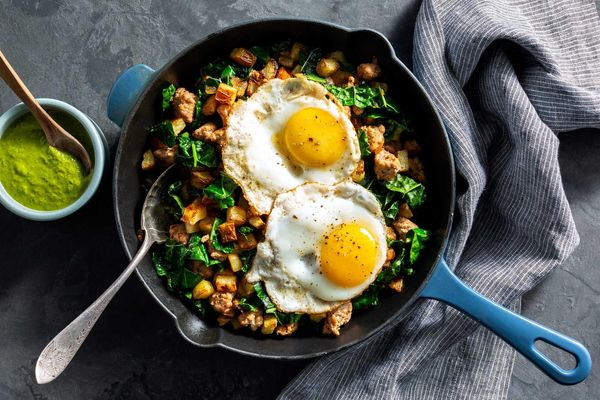 Turkey hash with runny eggs and spicy green harissa