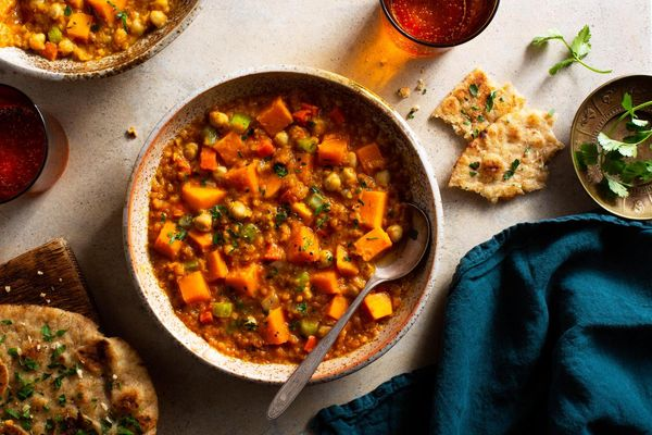 Spicy Tunisian chickpea and lentil stew with garlic flatbread