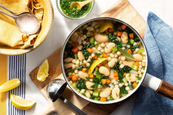 Butter beans and fregola en brodo with kale and pistou