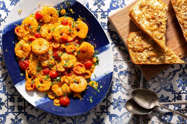Greek shrimp with roasted red pepper sauce and garlic-feta toasts