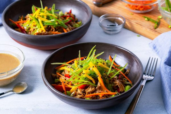 Spicy yuba noodle stir-fry with citrus-miso dressing and mango