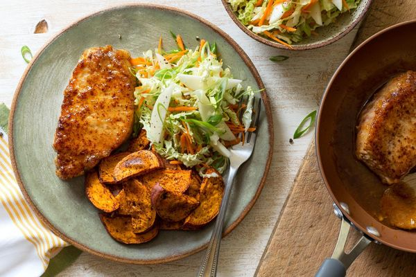 Orange chipotle–glazed pork with coleslaw and roasted sweet potato