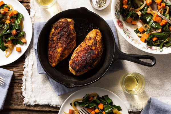 Blackened chicken breasts with collard greens and sweet potato